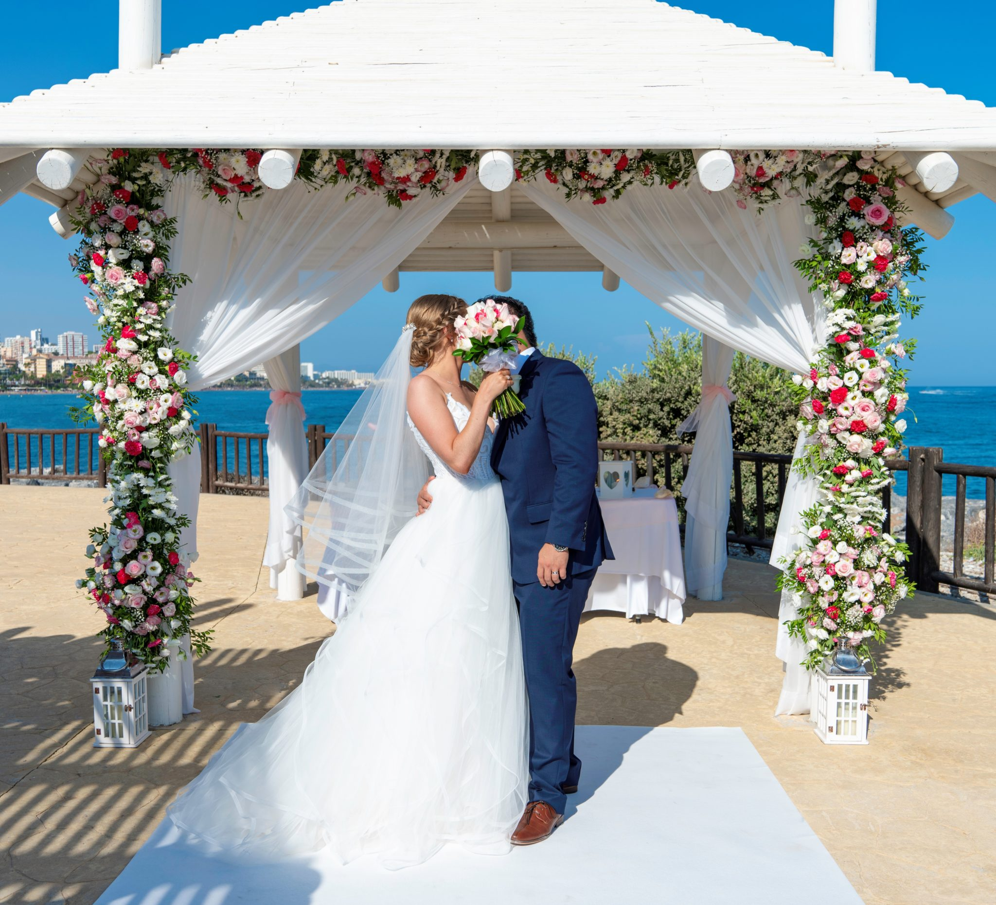 Silverscreen - Getting Married Spain - Sunset Beach Club Wedding Ceremony - New Chairs - Blue Bows - Destination Wedding Spain - Irish Photographer & Videographers - Sunset Beach Wedding