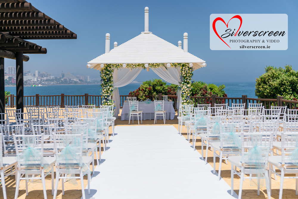 Sunset Beach Club Wedding set up - new chairs with blue bows