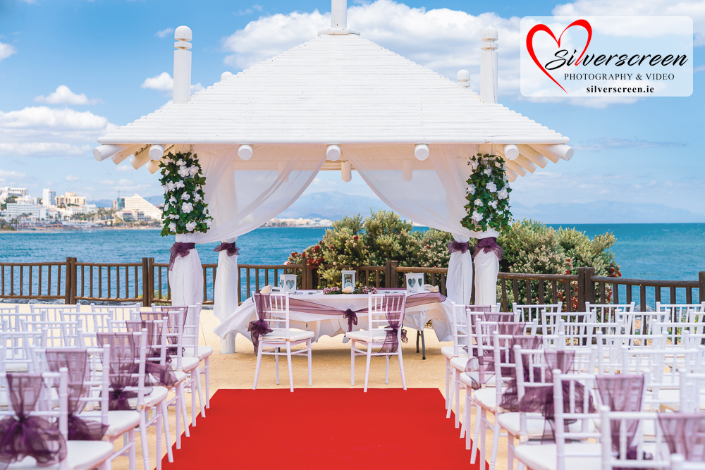 Sunset Beach Club Wedding set up - new chairs with purple bows
