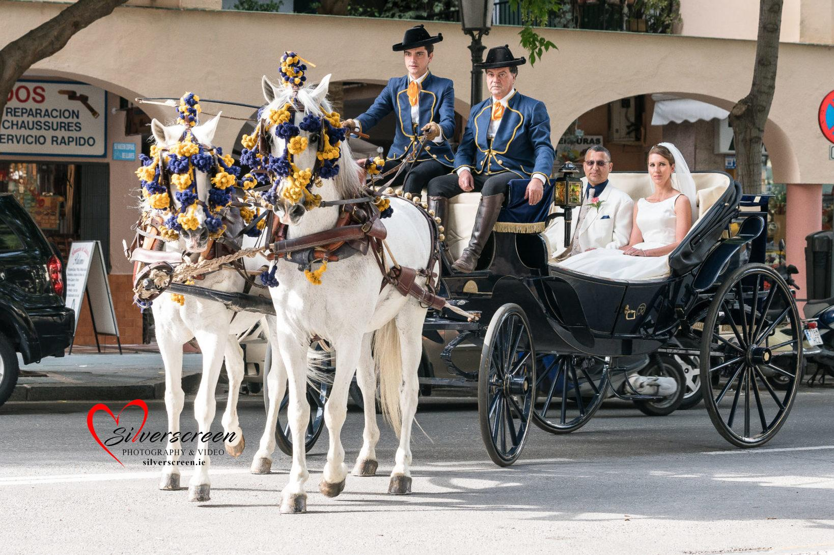 Bride and Groom arriving at Marbella Wedding on Horse and Carriage